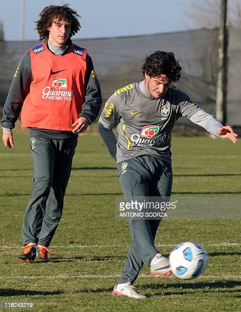 Brazilian footballer Alexandre Pato kicks the ball as teammate David looks on during a training session on July 5 in Campana 70 Km north from Buenos...