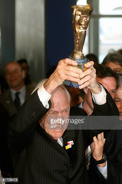 Brazilian footballer Bellini holds the Jules Rimet cup which Brazil received for winning the 1958 World Cup during the opening ceremony of an...