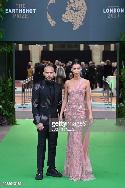 Brazilian footballer Dani Alves and his wife Joana Sanz arrive on the green carpet to attend the inaugural Earthshot Prize awards ceremony at...