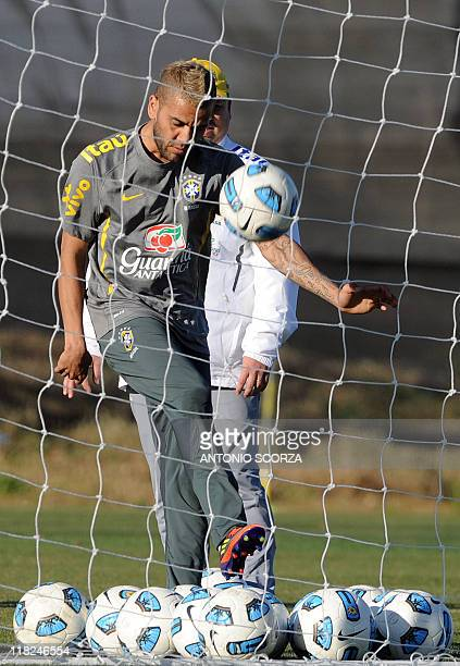 Brazilian footballer Daniel Alves kicks a ball during a training session on July 5 in Campana 70 Km north from Buenos Aires Brazil faces Paraguay...