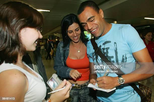 Brazilian footballer Denilson of Bordeaux arrives at Guarulhos International Airport ahead of Friday's wedding of Brazilian footballer Kaka who is...