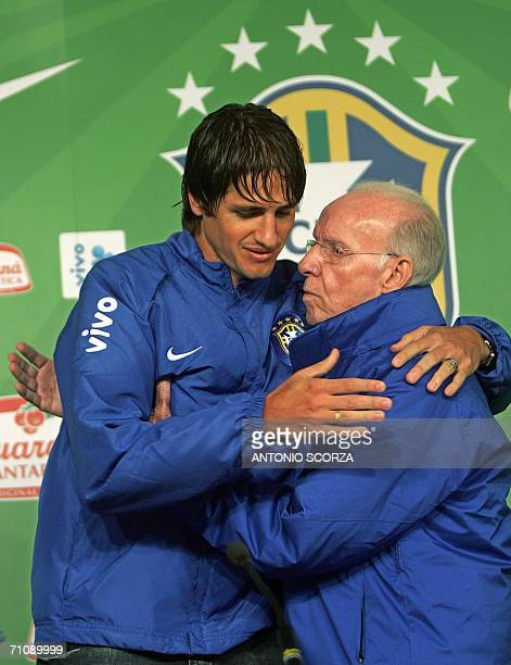 Brazilian footballer Edmilson is hugged by coach supervisor Mario Jorge Lobo Zagallo as he announces he has been ruled out of the World Cup with a...