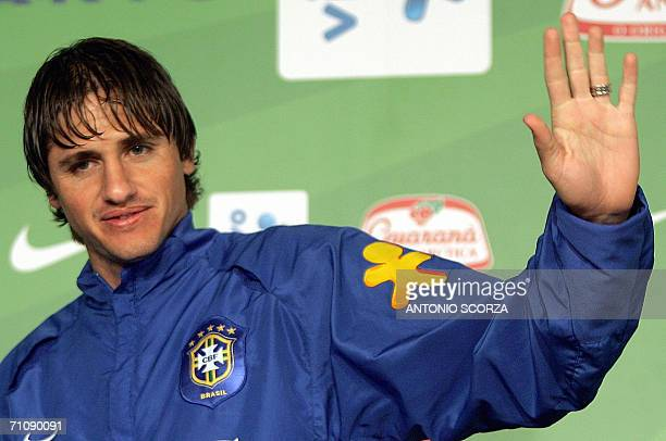 Brazilian footballer Edmilson waves as he announces his resignantion from the Brazilian national football team due to an injury in his right knee...