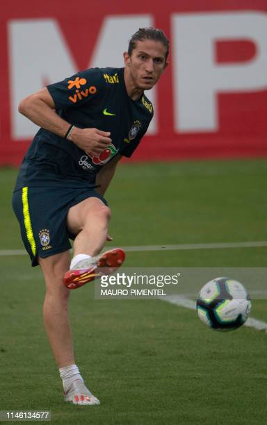 Brazilian footballer Filipe Luis takes part in a training session of the national team at Granja Comary sport complex in Teresopolis Brazil on May 24...