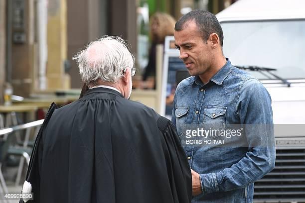 Brazilian footballer Hilton Vitorino Da Silva talks with his lawyer Maitre Pierre Marie Grappin as he arrives at the courthouse in AixenProvence on...
