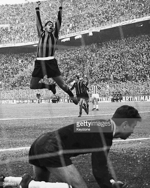 Brazilian footballer Jair celebrating after scoring a goal for Inter Milan against Juventus.