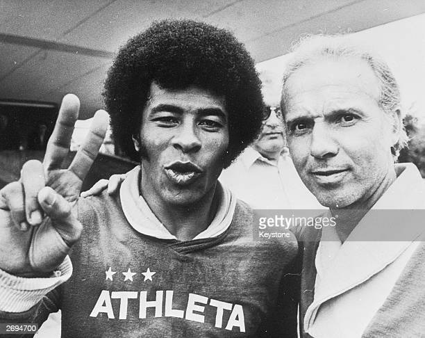 Brazilian footballer Jairzinho giving a victory sign before his team's game against Holland at Dortmund in the World Cup