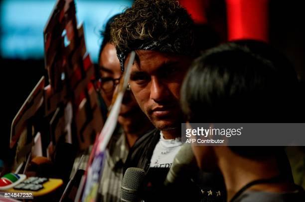 Brazilian footballer Neymar Jr looks on as he speaks to media at a fashion event in Shanghai on July 31 2017 Neymar hit the red carpet in Shanghai on...