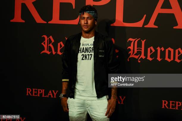 Brazilian footballer Neymar Jr poses for a photograph during a fashion event in Shanghai on July 31 2017 Neymar hit the red carpet in Shanghai on...