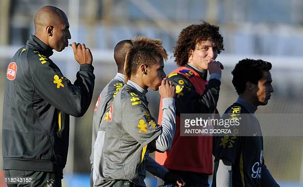 Brazilian footballer Neymar leaves the field with teammates after a training session on July 5 in Campana 70 Km north from Buenos Aires Brazil faces...