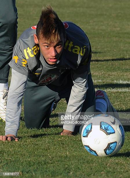 Brazilian footballer Neymar looks at the ball after falling during a training session on July 5 in Campana 70 Km north from Buenos Aires Brazil faces...