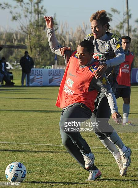 Brazilian footballer Neymar vies for the ball with teammate Lucas during a training session on July 5 in Campana 70 Km north from Buenos Aires Brazil...