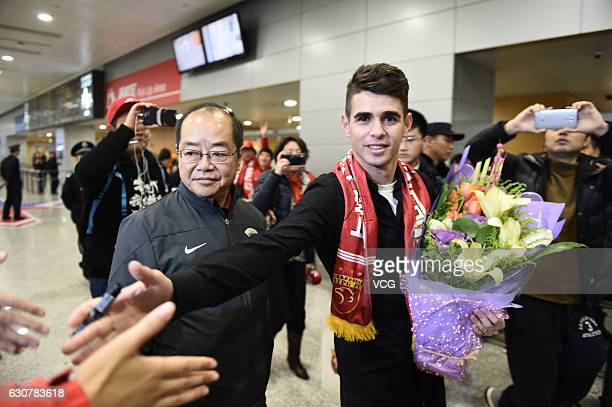 Brazilian footballer Oscar arrives at the airport on January 2 2017 in Shanghai China Oscar and Odil Ahmedov join China super league football club...