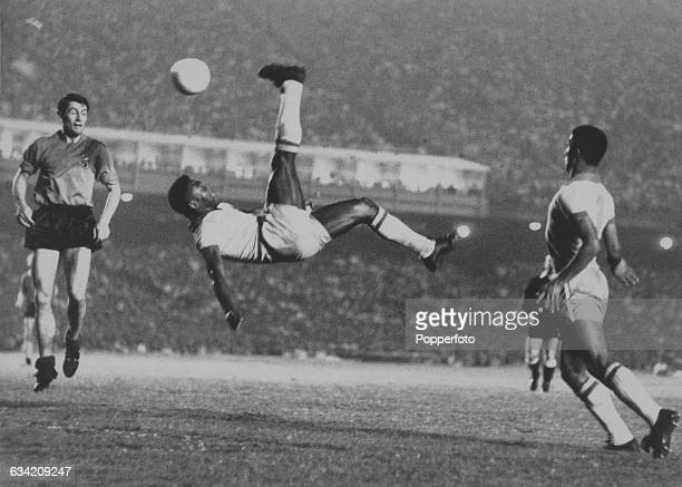 Brazilian footballer Pelé makes an attempt on goal with an athletic overhead kick during a Friendly International at the Maracana Stadium in Rio de...