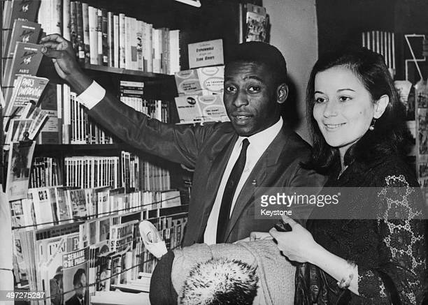 Brazilian footballer Pele and his wife Rosemeri dos Reis Cholbi shopping in Paris where they are honeymooning 17th March 1966