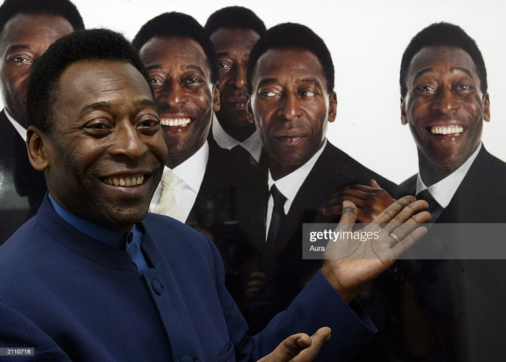 Brazilian footballer Pele appears at the opening of a photographic exhibition titled 'Pele, The King Through the Eye of the Camera' June 25, 2003 in Central London at the Eyestorm Gallery.