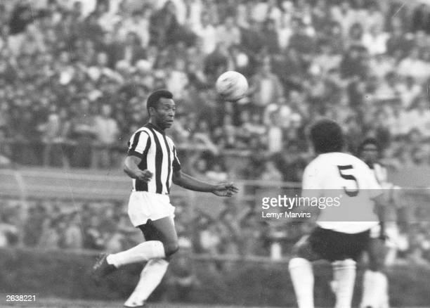 Brazilian footballer Pele in action