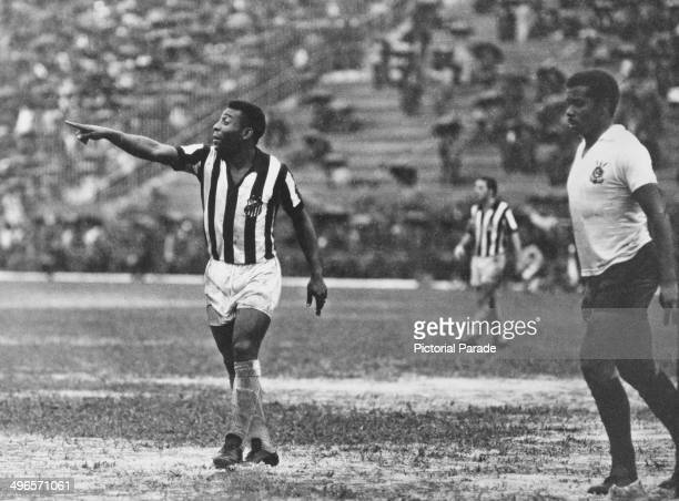 Brazilian footballer Pele playing for Santos against Corinthians, 1969.