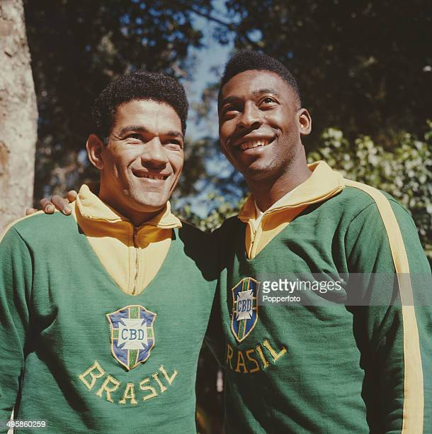 Brazilian footballer Pele posed on right with Garrincha both wearing Brazil national team uniform in 1962.