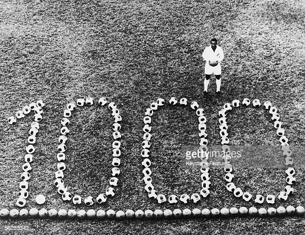 Brazilian footballer Pele stands by a display to celebrate his 1000th professional goal 14th December 1969