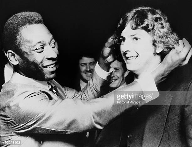 Brazilian footballer Pele teasing Trevor Francis star of Birmingham City FC about his hair 21st February 1972