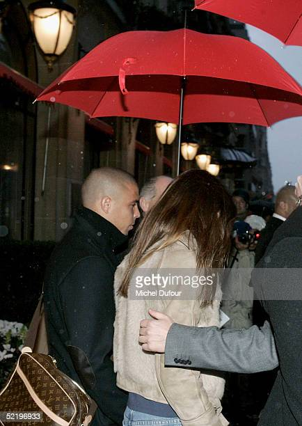 Brazilian footballer Ronaldo and fiance Daniela Cicarelli leave their Paris hotel The Plaza to attend their engagement party at Chantilly Chateau on...