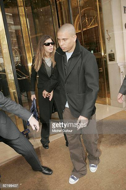 Brazilian footballer Ronaldo and fiance Daniela Cicarelli leave their Paris hotel The Plaza to go back to Barcelona on February 15 2005 in Paris...