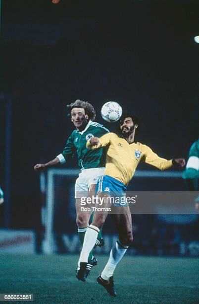 Brazilian footballer Sócrates clashes with Andreas Brehme during an International Friendly against West Germany at the Waldstadion in Frankfurt...