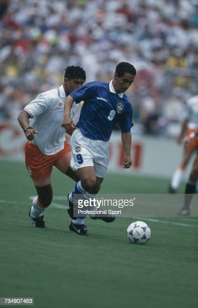 Brazilian footballer Zinho pictured with the ball as Dutch midfielder Frank Rijkaard attempts to gain possession during play in the 1994 FIFA World...