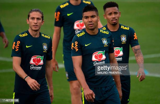 Brazilian footballers Filipe Luis Casemiro and Gabriel Jesus take part in a training session of the national team at Granja Comary sport complex in...