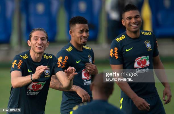 Brazilian footballers Filipe Luis Gabriel Jesus and Casemiro laugh during a training session of the national team at Granja Comary sport complex in...