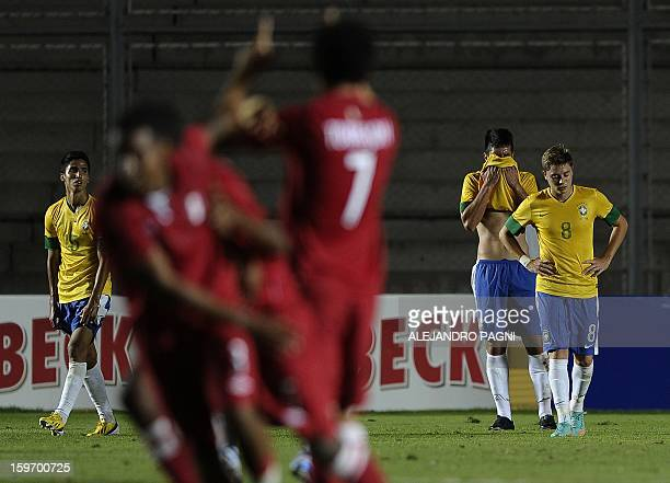 Brazilian footballers react in dejection after Peruvian midfielder Edison Flores scored his team's second goal during their South American U-20...