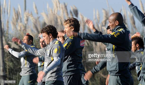Brazilian footballers warm up during a training session on July 5 in Campana 70 Km north from Buenos Aires Brazil faces Paraguay next July 9 in a...