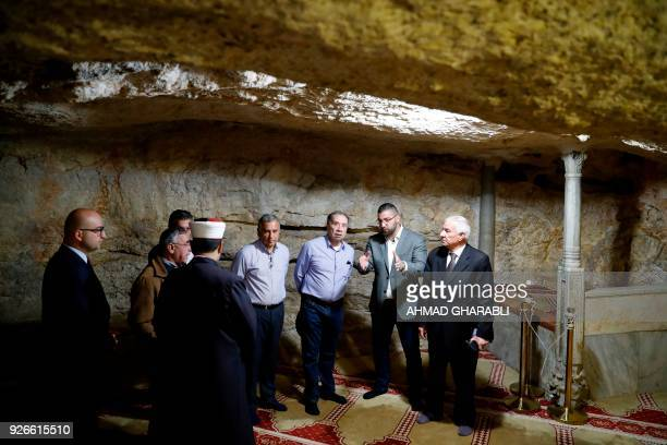 Brazilian Foreign Minister Aloysio Nunes tours inside the cave beneath the Dome of the Rock in alAqsa mosque compound in Jerusalem's Old City on...