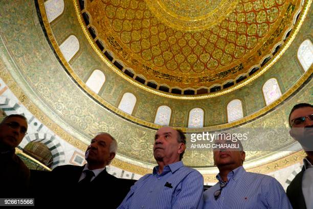 Brazilian Foreign Minister Aloysio Nunes tours the inside of the Dome of the Rock in alAqsa mosque compound in Jerusalem's Old City on March 3 2018 /...