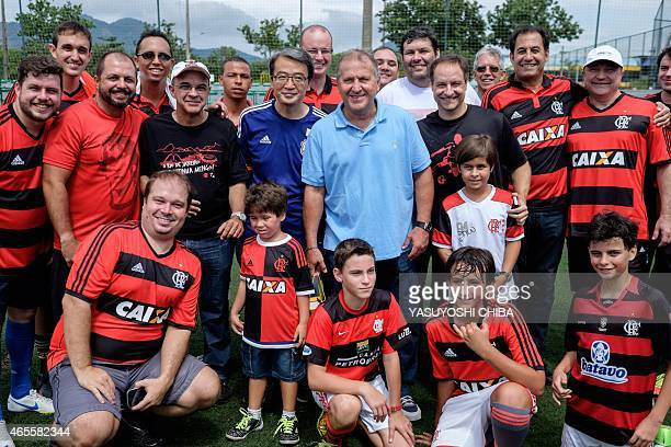 Brazilian former football player Arthur Coimbra aka Zico poses with Japanese ConsulGeneral Tsuyoshi Yamamoto and the president of the Flamengo...