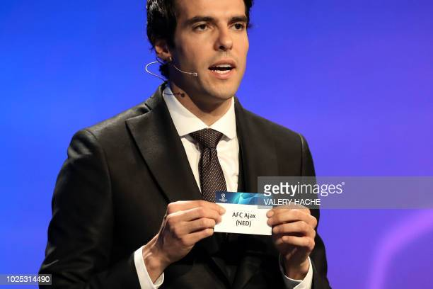 Brazilian former football player Kaka shows the name of Ajax Amsterdam during the draw for UEFA Champions League football tournament at The Grimaldi...
