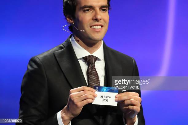 Brazilian former football player Kaka shows the name of AS Roma during the draw for UEFA Champions League football tournament at The Grimaldi Forum...