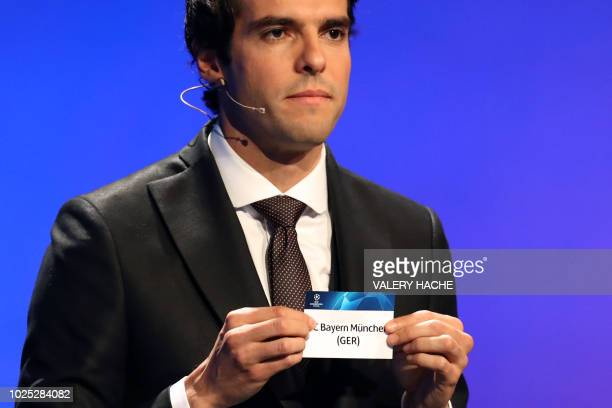Brazilian former football player Kaka shows the name of Bayern Munich during the draw for UEFA Champions League football tournament at The Grimaldi...