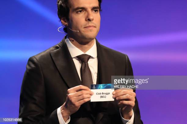 Brazilian former football player Kaka shows the name of Club Brugge during the draw for UEFA Champions League football tournament at The Grimaldi...