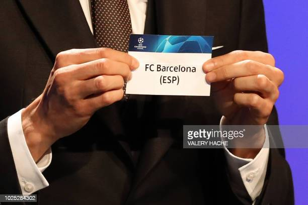 Brazilian former football player Kaka shows the name of FC Barcelona during the draw for UEFA Champions League football tournament at The Grimaldi...
