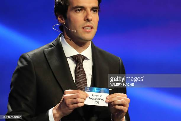 Brazilian former football player Kaka shows the name of Juventus football club during the draw for UEFA Champions League football tournament at The...