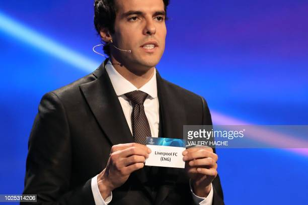 Brazilian former football player Kaka shows the name of Liverpool during the draw for UEFA Champions League football tournament at The Grimaldi Forum...