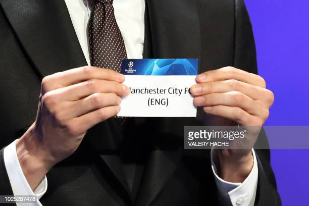 Brazilian former football player Kaka shows the name of Manchester City during the draw for UEFA Champions League football tournament at The Grimaldi...