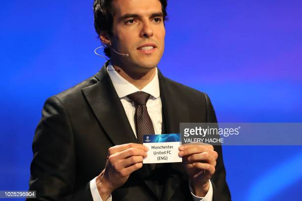 Brazilian former football player Kaka shows the name of Manchester United during the draw for UEFA Champions League football tournament at The...