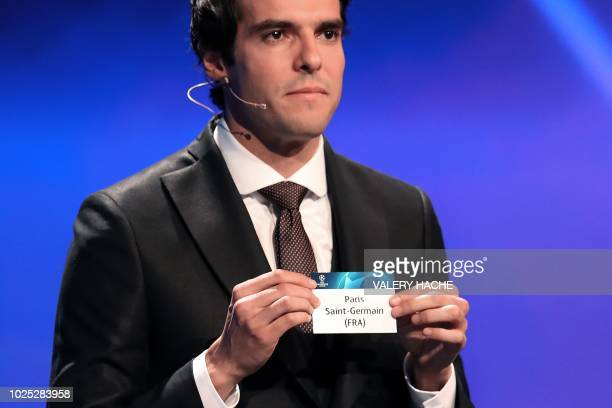 Brazilian former football player kaka shows the name of Paris SaintGermain during the draw for UEFA Champions League football tournament at The...