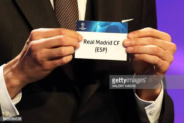 Brazilian former football player Kaka shows the name of Real Madrid during the draw for UEFA Champions League football tournament at The Grimaldi...