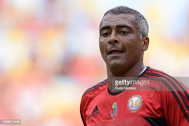Brazilian former football star Romario looks on during a charity football match organized by former Brazilian national team player Zico at Maracana...
