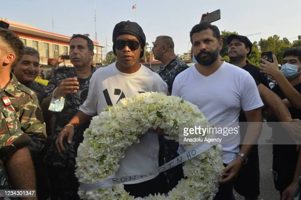 Brazilian former football star Ronaldinho lays a wreath of flowers in remembrance of victims of the blasts that rocked Beirut's port on Aug. 4, 2020...
