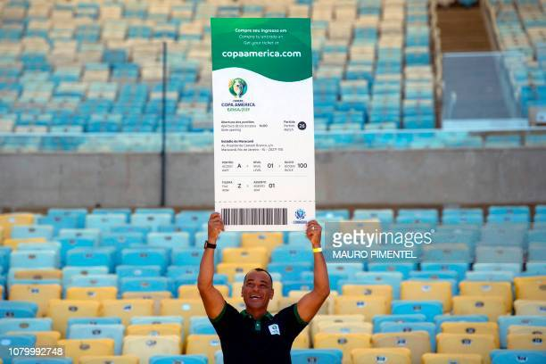 Brazilian former footballer Cafu poses for a picture showing a Copa America 2019 giant ticket after a press conference of the Copa America Local...